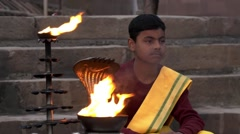 Varanasi, india, young monk and sacred fire Stock Footage