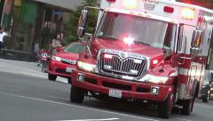 EMS races by, siren, responding Stock Footage