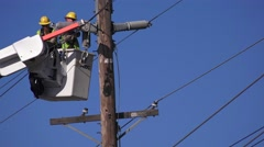 Public utility power company working - stock footage