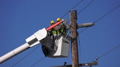 Repairing damaged power lines Stock Footage