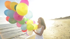 Girl having fun with ballons Stock Footage