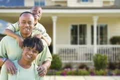 Happy Attractive African American Family in Front of Beautiful House. Stock Photos