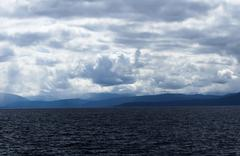 Storm Clouds Over Lake Tahoe California And Mountains - stock photo