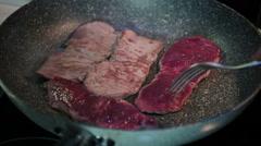 Steaks Flipped in Frying Pan Stock Footage