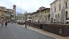 Tourists walking POV on visit at Verona Erbe Square Stock Footage