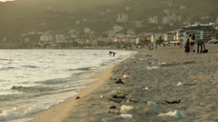 ALANYA, TURKEY - APR 25, 2015: Garbage on a famous sandy Cleopatra Beach Stock Footage