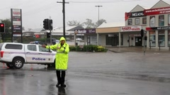 MORAYFIELD, AUSTRALIA - FEBRUARY 21: Police controlling flooded roadway Stock Footage