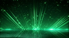 Green light beams and shimmering particles loopable background Stock Footage