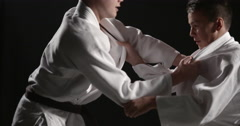 Judo struggle between two young athletes Stock Footage