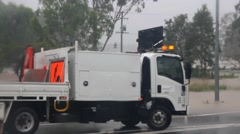 MORAYFIELD, AUSTRALIA - FEBRUARY 21: Council truck parked to close flooded road Stock Footage