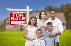 Stock Photo of Hispanic Family, New Home and For Sale Real Estate Sign