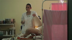 Midwife preparing woman for childbirth. Pregnant woman lying on table for birth. - stock footage