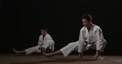 Two young Judoka's warming up 3 Stock Footage