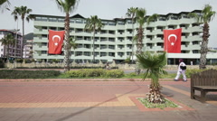 ALANYA, TURKEY - APR 23 2015: Turkish flags hanging on the street in honor of - stock footage