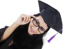 Excited bachelor with graduation gown Stock Photos