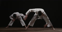 Two young Judoka's warming up Stock Footage