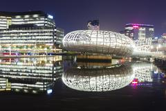 View of Webb Bridge and modern buildings in Docklands, Melbourne at night - stock photo