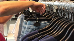 Buying jeans clothes items Stock Footage