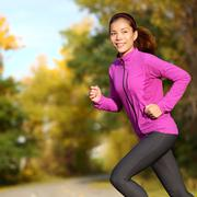 Young Asian woman running female jogger happy - Female runner jogging - stock photo
