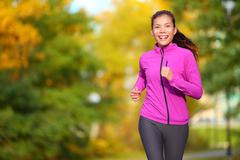 Female jogger - young woman jogging in the park running - stock photo