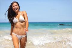 People having summer beach fun - woman in water Stock Photos