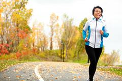 Mature Asian woman running active in her 50s Stock Photos