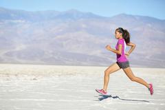 Runner woman running and sprinting on trail run - Female sport fitness athlete Kuvituskuvat