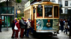 Portugal Porto Oporto Tourists commuters getting on nostalgic Tram - stock footage