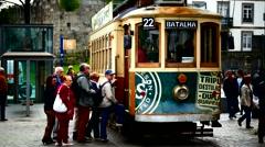 Portugal Porto Oporto Tourists commuters getting on nostalgic Tram Stock Footage