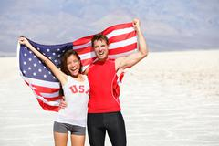 USA athletes people holding american flag cheering - stock photo
