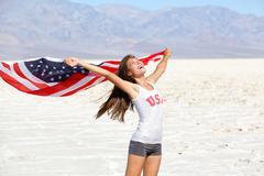 USA flag  woman athlete showing american flag - US sport athlete winner Kuvituskuvat