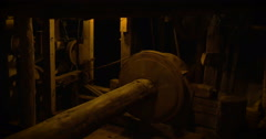 Pulley detail in an ancient wooden sawmill - stock footage