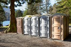 Portapotty in a park yard for public convenience - stock photo