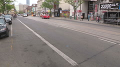 Commuters on bycicles transit foot and cars in downtown urban Toronto Stock Footage