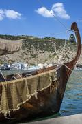 Pleasure craft the style of old , anchored at the waterfront of Balaklava bay - stock photo