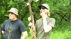 Stock Video Footage of 4K two men with guns and cigars posing