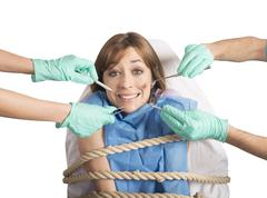 Tied to the dentist - stock photo