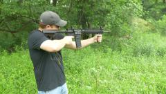 4k man slow motion shooting assault rifle with shells ejecting towards camera Stock Footage