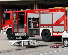 road accident with car parts and the firetruck - stock photo