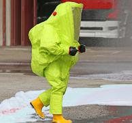 Man with yellow protective gear against biological risk Stock Photos
