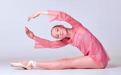Young ballerina dancer showing her techniques - stock photo