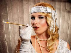 beautiful blond flapper girl smoking - stock photo
