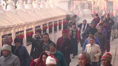 Pilgrims walk circle around Boudhanath stupa in Kathmandu, Nepal Stock Footage