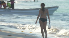 Stock Video Footage of Girl in swimsuit walking on the beach in the Dominican Republic