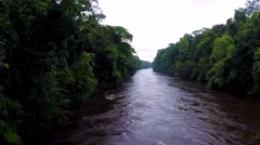 The river in the jungle. The camera slowly rises over the rainforest Stock Footage