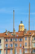 Tenement houses and church in the port of Saint-Tropez - stock photo
