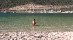 Child with character standing in the sea Stock Footage