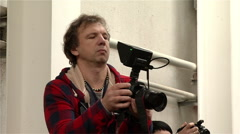 Camera with additional monitor as a camcorder to the shooting Stock Footage