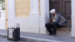 old street man with acordeon-street musician performer - stock footage