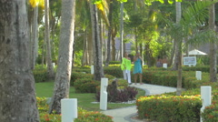 Walking through the Vista Sol Hotel park in The Dominican Republic Stock Footage